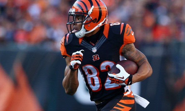 CINCINNATI, OH - OCTOBER 27:  Marvin Jones #82 of the Cincinnati Bengals runs with the ball during the NFL game against the New York Jets at Paul Brown Stadium on October 27, 2013 in Cincinnati, Ohio.  (Photo by Andy Lyons/Getty Images)