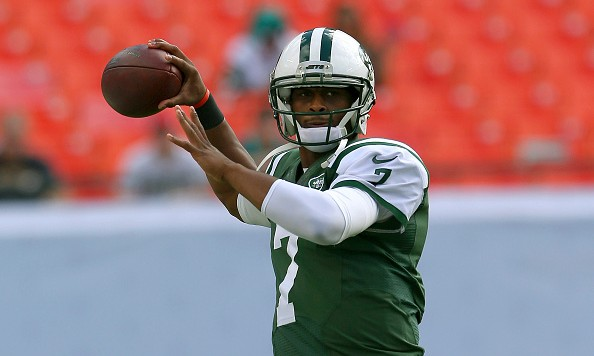 MIAMI GARDENS, FL - DECEMBER 28:  Quarterback Geno Smith #7 of the New York Jets throws during pregame workouts before the Jets met the Miami Dolphins at Sun Life Stadium on December 28, 2014 in Miami Gardens, Florida.  (Photo by Mike Ehrmann/Getty Images)