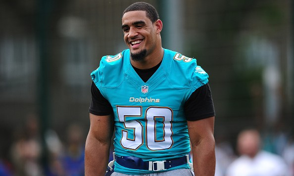 LONDON, ENGLAND - JULY 15:  Olivier Vernon of the Miami Dolphins helps to coach a team of local school children during the NFL Launch of the Play 60 scheme at the Black Prince Community Hub on July 15, 2015 in London, England.  (Photo by Dan Mullan/Getty Images)