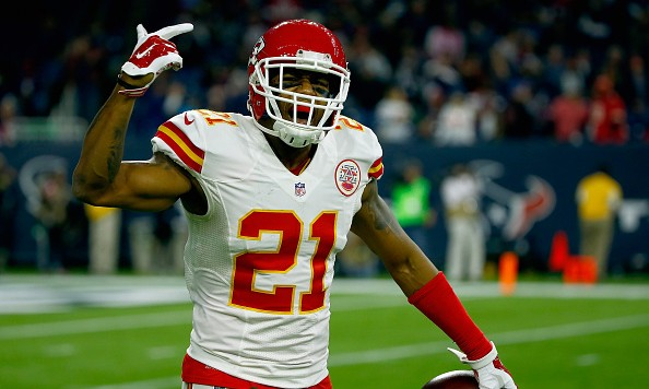 HOUSTON, TX - JANUARY 09:  Sean Smith #21 of the Kansas City Chiefs celebrates his interception against the Houston Texans in the fourth quarter during the AFC Wild Card Playoff game at NRG Stadium on January 9, 2016 in Houston, Texas. The Kansas City Chiefs won 30-0 over the Houston Texans. (Photo by Scott Halleran/Getty Images)