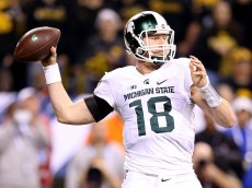 INDIANAPOLIS, IN - DECEMBER 05:  Connor Cook #18 of the Michigan State Spartans throws against the Iowa Hawkeyes in the Big Ten Championship at Lucas Oil Stadium on December 5, 2015 in Indianapolis, Indiana.  (Photo by Andy Lyons/Getty Images)