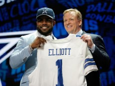 CHICAGO, IL - APRIL 28:  (L-R) Ezekiel Elliott of Ohio State holds up a jersey with NFL Commissioner Roger Goodell after being picked #4 overall by the Dallas Cowboys during the first round of the 2016 NFL Draft at the Auditorium Theatre of Roosevelt University on April 28, 2016 in Chicago, Illinois.  (Photo by Jon Durr/Getty Images)