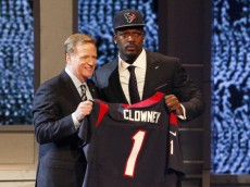 NEW YORK, NY - MAY 08:  Jadeveon Clowney of the South Carolina Gamecocks stands on stage with NFL Commissioner Roger Goodell after he was picked #1 overall by the Houston Texansduring the first round of the 2014 NFL Draft at Radio City Music Hall on May 8, 2014 in New York City.  (Photo by Cliff Hawkins/Getty Images)
