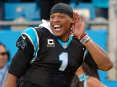 CHARLOTTE, NC - DECEMBER 13:  Cam Newton #1 of the Carolina Panthers listens to the fans cheer during the final seconds of a win against the Atlanta Falcons at Bank of America Stadium on December 13, 2015 in Charlotte, North Carolina. The Panthers won 38-0.  (Photo by Grant Halverson/Getty Images)