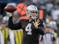OAKLAND, CA - AUGUST 28: Quarterback Derek Carr #4 of the Oakland Raiders passes the ball against the Seattle Seahawks during a preseason game at O.co Coliseum on August 28, 2014 in Oakland, California.  (Photo by Ezra Shaw/Getty Images)