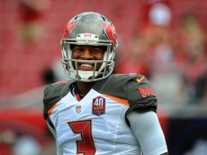 TAMPA, FL - SEPTEMBER 13: Quarterback Jameis Winston #3 of the Tampa Bay Buccaneers talks with teammates in pregame warmups prior to the game against the Tennessee Titans at Raymond James Stadium on September 13, 2015 in Tampa, Florida. (Photo by Cliff McBride/Getty Images) *** Local Caption ***  Jameis Winston