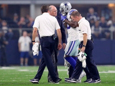ARLINGTON, TX - SEPTEMBER 25:  Dez Bryant #88 of the Dallas Cowboys is assisted by team personel after taking a hit from the Chicago Bears at AT&T Stadium on September 25, 2016 in Arlington, Texas.  (Photo by Tom Pennington/Getty Images)