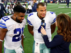 ARLINGTON, TX - SEPTEMBER 25:  [L] Dak Prescott #4 and Ezekiel Elliott #21 of the Dallas Cowboys speak to the media after winning a game between the Dallas Cowboys and the Chicago Bears at AT&T Stadium on September 25, 2016 in Arlington, Texas.  (Photo by Tom Pennington/Getty Images)
