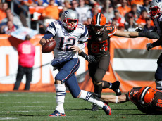 CLEVELAND, OH - OCTOBER 09: Tom Brady #12 of the New England Patriots looks to pass while under pressure in the third quarter of the game against the Cleveland Browns at FirstEnergy Stadium on October 9, 2016 in Cleveland, Ohio. The Patriots defeated the Browns 33-13. (Photo by Joe Robbins/Getty Images)