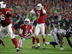 GLENDALE, AZ - OCTOBER 23: Defensive back D.J. Swearinger #36 and free safety Tyrann Mathieu #32 of the Arizona Cardinals celebrate after a tackle made on running back C.J. Prosise #22 of the Seattle Seahawks during the game at University of Phoenix Stadium on October 23, 2016 in Glendale, Arizona. The Seattle Seahawks and Arizona Cardinals tied 6-6. (Photo by Norm Hall/Getty Images)