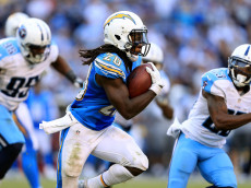SAN DIEGO, CA - NOVEMBER 06:   Melvin Gordon #28 of the San Diego Chargers runs with the ball as Jurrell Casey #99 of the Tennessee Titans chases during the second half of a game at Qualcomm Stadium on November 6, 2016 in San Diego, California.  (Photo by Sean M. Haffey/Getty Images)