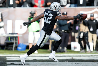 OAKLAND, CA - NOVEMBER 27:  Khalil Mack #52 of the Oakland Raiders scores after intercepting Cam Newton #1 of the Carolina Panthers in the second quarter of their NFL game on November 27, 2016 in Oakland, California.  (Photo by Lachlan Cunningham/Getty Images)