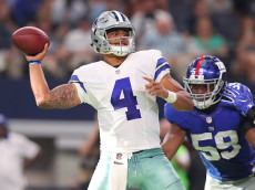 ARLINGTON, TX - SEPTEMBER 11:  Dak Prescott #4 of the Dallas Cowboys drops back to pass during the fourth quarter against the New York Giants at AT&T Stadium on September 11, 2016 in Arlington, Texas.  (Photo by Tom Pennington/Getty Images)