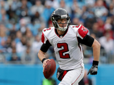 CHARLOTTE, NC - DECEMBER 24:  Matt Ryan #2 of the Atlanta Falcons runs the ball against the Carolina Panthers in the 3rd quarter during their game at Bank of America Stadium on December 24, 2016 in Charlotte, North Carolina.  (Photo by Streeter Lecka/Getty Images)