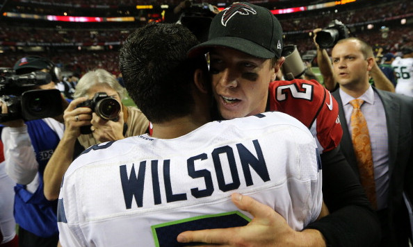 ATLANTA, GA - JANUARY 13:   Russell Wilson #3 of the Seattle Seahawks and  Matt Ryan #2 of the Atlanta Falcons embrace after the Falcons defeated the Seahawks during the NFC Divisional Playoff Game at Georgia Dome on January 13, 2013 in Atlanta, Georgia.  (Photo by Streeter Lecka/Getty Images)
