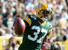 GREEN BAY, WI - OCTOBER 06:  Sam Shields #37 of the Green Bay Packers reacts as he is called for a penalty during the game against the Detroit Lions at Lambeau Field on October 6, 2013 in Green Bay, Wisconsin.  (Photo by Harry How/Getty Images)
