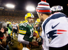GREEN BAY, WI - NOVEMBER 30:  Quarterbacks Aaron Rodgers #12 of the Green Bay Packers and Tom Brady #12 of the New England Patriots shake hands following the NFL game at Lambeau Field on November 30, 2014 in Green Bay, Wisconsin. The Packers defeated the Patriots 26-21.  (Photo by Christian Petersen/Getty Images)