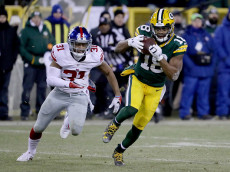 GREEN BAY, WI - JANUARY 08:  Randall Cobb #18 of the Green Bay Packers runs with the ball while being chased by Trevin Wade #31 of the New York Giants in the third quarter during the NFC Wild Card game at Lambeau Field on January 8, 2017 in Green Bay, Wisconsin.  (Photo by Jonathan Daniel/Getty Images)