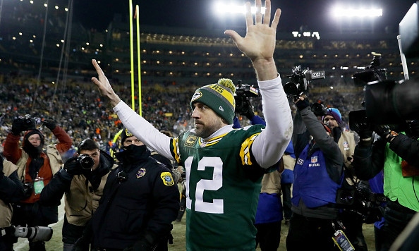 GREEN BAY, WI - JANUARY 8:  Aaron Rodgers #12 of the Green Bay Packers walks off the field after beating the New York Giants 38-13 in the NFC Wild Card game at Lambeau Field on January 8, 2017 in Green Bay, Wisconsin. (Photo by Jonathan Daniel/Getty Images)