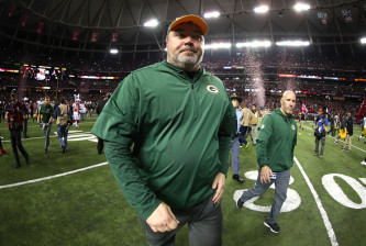 ATLANTA, GA - JANUARY 22:  Head coach Mike McCarthy of the Green Bay Packers walks off the field after being defeated by the Atlanta Falcons in the NFC Championship Game at the Georgia Dome on January 22, 2017 in Atlanta, Georgia. The Falcons defeated the Packers 44-21.  (Photo by Tom Pennington/Getty Images)