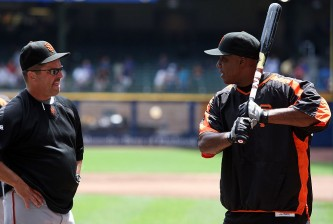 MILWAUKEE - JULY 21:  Barry Bonds #25 of the San Francisco Giants talks with hitting coach Joe Lefebvre #16 during batting practice prior to the game against the Milwaukee Brewers on July 21, 2007 at Miller Park in Milwaukee, Wisconsin.  (Photo by Jamie Squire/Getty Images)