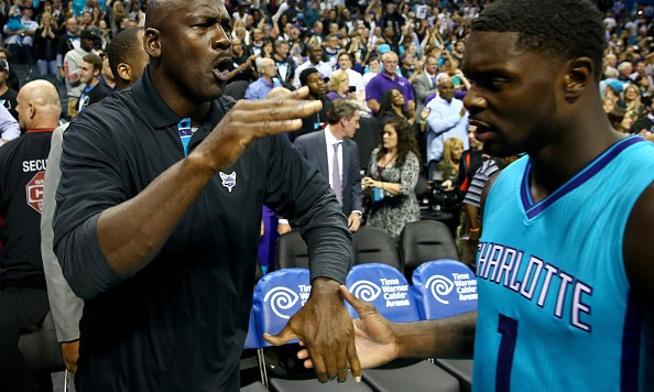 CHARLOTTE, NC - OCTOBER 29:  (L-R) Michael Jordan, owner of the Charlotte Hornets, celebrates with Lance Stephenson #1 of the Charlotte Hornets (Photo by Streeter Lecka/Getty Images)