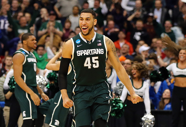SYRACUSE, NY - MARCH 27:  Denzel Valentine #45 of the Michigan State Spartans celebrates after defeating the Oklahoma Sooners 62 to 58 during the East Regional Semifinal of the 2015 NCAA Men's Basketball Tournament at the Carrier Dome on March 27, 2015 in Syracuse, New York.  (Photo by Elsa/Getty Images)