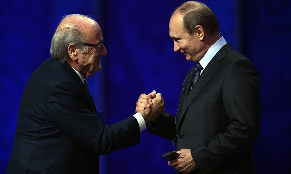 SAINT PETERSBURG, RUSSIA - JULY 25:  FIFA President Joseph S. Blatter shakes hands with Vladimir Putin, President of Russia during the Preliminary Draw of the 2018 FIFA World Cup in Russia at The Konstantin Palace on July 25, 2015 in Saint Petersburg, Russia.  (Photo by Dennis Grombkowski/Getty Images)