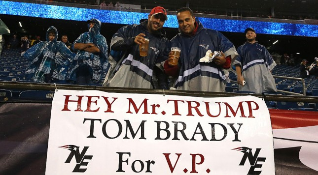 "FOXBORO, MA - SEPTEMBER 10: Fans stand with a sign stating ""Hey Mr. Trump Tom Brady for V.P."" before the game between the New England Patriots and the Pittsburgh Steelers at Gillette Stadium on September 10, 2015 in Foxboro, Massachusetts.  (Photo by Jim Rogash/Getty Images)"