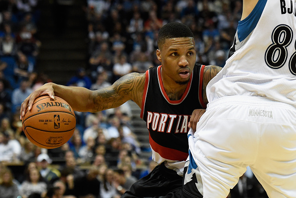 MINNEAPOLIS, MN - NOVEMBER 2: Damian Lillard #0 of the Portland Trail Blazers controls the ball during the first quarter of the home opening game against the Minnesota Timberwolves on November 2, 2015 at Target Center in Minneapolis, Minnesota. The Trail Blazers defeated the Timberwolves 106-101. NOTE TO USER: User expressly acknowledges and agrees that, by downloading and or using this Photograph, user is consenting to the terms and conditions of the Getty Images License Agreement. (Photo by Hannah Foslien/Getty Images)
