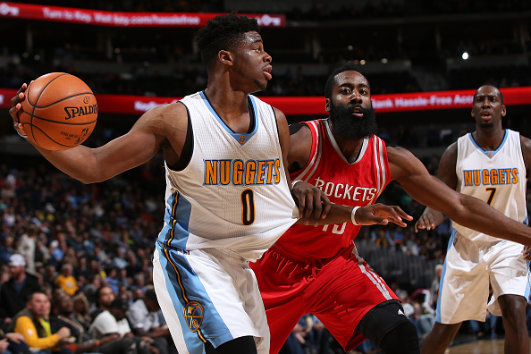 DENVER, CO - NOVEMBER 13:  Emmanuel Mudiay #0 of the Denver Nuggets controls the ball against James Harden #13 of the Houston Rockets at Pepsi Center on November 13, 2015 in Denver, Colorado. The Nuggets defeated the Rockets 107-98. NOTE TO USER: User expressly acknowledges and agrees that, by downloading and or using this photograph, User is consenting to the terms and conditions of the Getty Images License Agreement.  (Photo by Doug Pensinger/Getty Images)