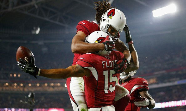 GLENDALE, AZ - DECEMBER 10: Wide receiver Michael Floyd #15 of the Arizona Cardinals celebrates with wide receiver Larry Fitzgerald #11 after scoring a 42 yard touchdown during the third quarter of the NFL game against the Minnesota Vikings at the University of Phoenix Stadium on December 10, 2015 in Glendale, Arizona.  (Photo by Christian Petersen/Getty Images)