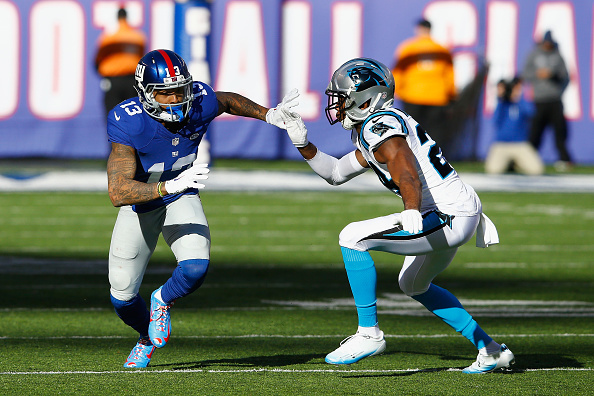 EAST RUTHERFORD, NJ - DECEMBER 20:  Odell Beckham #13 of the New York Giants in action against Josh Norman #24 of the Carolina Panthers during their game at MetLife Stadium on December 20, 2015 in East Rutherford, New Jersey.  (Photo by Michael Reaves/Getty Images)