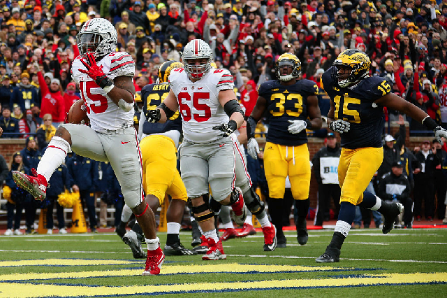 ANN ARBOR, MI - NOVEMBER 28: Running back Ezekiel Elliott #15 of the Ohio State Buckeyes celebrates after rushing for a second quarter touchdown against the Michigan Wolverines at Michigan Stadium on November 28, 2015 in Ann Arbor, Michigan. (Photo by Gregory Shamus/Getty Images)
