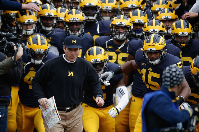 ANN ARBOR, MI - NOVEMBER 28: Head coach Jim Harbaugh of the Michigan Wolverines leads his team on the field before the start of their game against the Ohio State Buckeyes at Michigan Stadium on November 28, 2015 in Ann Arbor, Michigan. (Photo by Gregory Shamus/Getty Images)