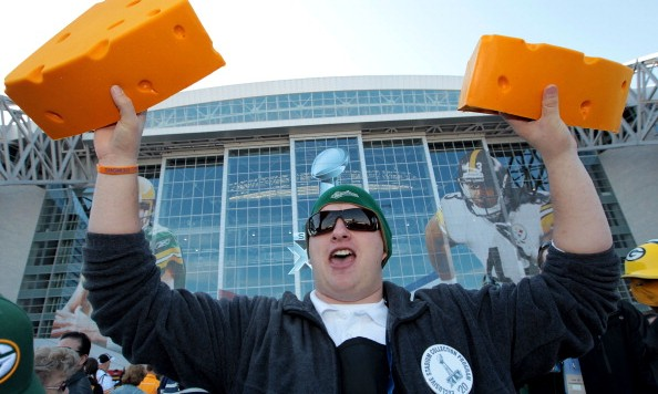 ARLINGTON, TX - FEBRUARY 06:  A vendor sells cheese head hats for Green Bay Packers fans before they play against the Pittsburgh Steelers in Super Bowl XLV at Cowboys Stadium on February 6, 2011 in Arlington, Texas.  (Photo by Jamie Squire/Getty Images)