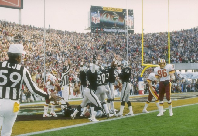 22  Jan 1984:  The Los Angeles Raiders celebrate a touchdown against  the Washington Redskins in Super Bowl XVIII at Tampa Stadium in Tampa, Florida. The Raiders won the game, 38-9. Mandatory Credit: Allsport  /Allsport