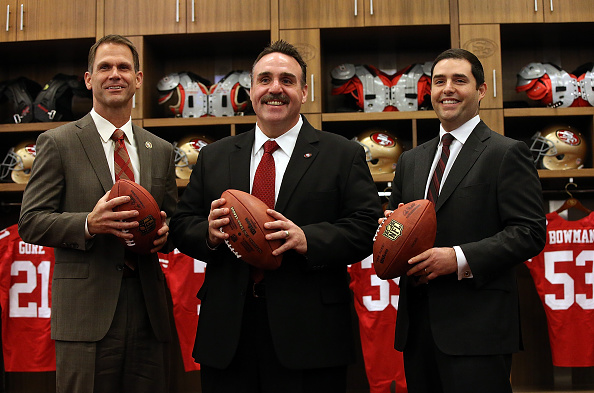 SANTA CLARA, CA - JANUARY 15:  Jim Tomsula (C) stands with San Francisco 49ers CEO Jed York (R) and 49ers general manager Trent Baalke following a press conference at Levi's Stadium on January 15, 2015 in Santa Clara, California. The San Francisco 49ers announced Jim Tomsula as their new head coach to replace Jim Harbaugh.  (Photo by Justin Sullivan/Getty Images)
