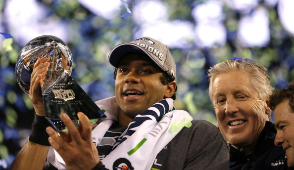EAST RUTHERFORD, NJ - FEBRUARY 02:  Quarterback Russell Wilson #3 of the Seattle Seahawks celebrates with the Vince Lombardi Trophy alongside head coach Pete Carroll after their 43-8 victory over the Denver Broncos during Super Bowl XLVIII at MetLife Stadium on February 2, 2014 in East Rutherford, New Jersey.  (Photo by Kevin C. Cox/Getty Images)
