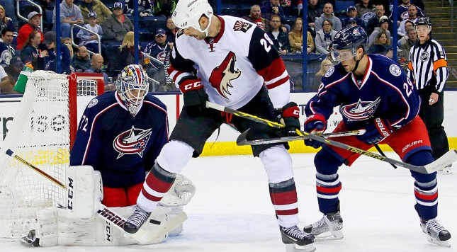 COLUMBUS, OH - NOVEMBER 14:  John Scott #28 of the Arizona Coyotes attempts to set a screen in front of Sergei Bobrovsky #72 of the Columbus Blue Jackets while being defended by Cody Goloubef #29 of the Columbus Blue Jackets during the first period on November 14, 2015 at Nationwide Arena in Columbus, Ohio. (Photo by Kirk Irwin/Getty Images)