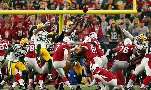 GLENDALE, AZ - DECEMBER 27:  Strong safety Micah Hyde #33, defensive end Datone Jones #95 and outside linebacker Mike Neal #96 of the Green Bay Packers attempt to block an extra point kicked by kicker Chandler Catanzaro #7 of the Arizona Cardinals during the NFL game at the University of Phoenix Stadium on December 27, 2015 in Glendale, Arizona.  The Cardinals defeated the Packers 38-8. (Photo by Christian Petersen/Getty Images)