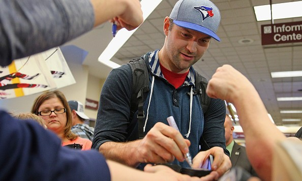 NASHVILLE, TN - JANUARY 28:  John Scott of the St. John's IceCaps signs autographs for fans on arrival at the Nashville International Airport on January 28, 2016 in Nashville, Tennessee. Scott will take part in the 2016 NHL All-Star Festivities this weekend at the Bridgestone Arena.  (Photo by Bruce Bennett/Getty Images)
