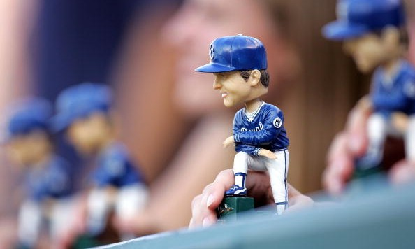 KANSAS CITY, MO - JULY 22:  A fan displays a bobblehead of former manager Dick Howser of the Kansas City Royals during the game between the Royals and the Los Angeles Angels of Anaheim on Dick Howser bobblehead giveaway night on July 22, 2006 at Kauffman Stadium in Kansas City, Missouri.  (Photo by Jamie Squire/Getty Images)