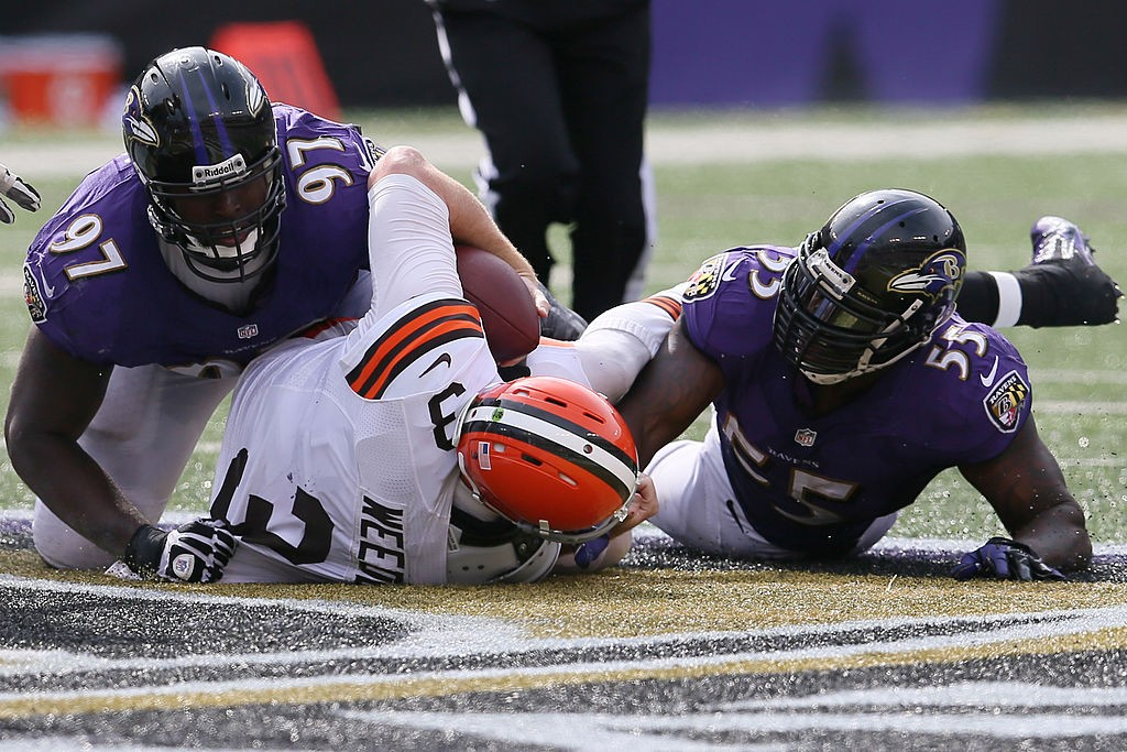 BALTIMORE, MD - SEPTEMBER 15: Arthur Jones #97 and Terrell Suggs #55 of the Baltimore Ravens sack quarterback Brandon Weeden #3 of the Cleveland Browns during the second half of the Ravens 14-6 win at M&T Bank Stadium on September 15, 2013 in Baltimore, Maryland.  (Photo by Rob Carr/Getty Images)
