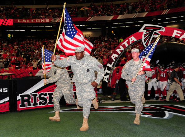 ATLANTA, GA - NOVEMBER 10: Members of the Military lead the Atlanta Falcons onto the field for the game against the Seattle Seahawks at the Georgia Dome on November 10, 2013 in Atlanta, Georgia. (Photo by Scott Cunningham/Getty Images)