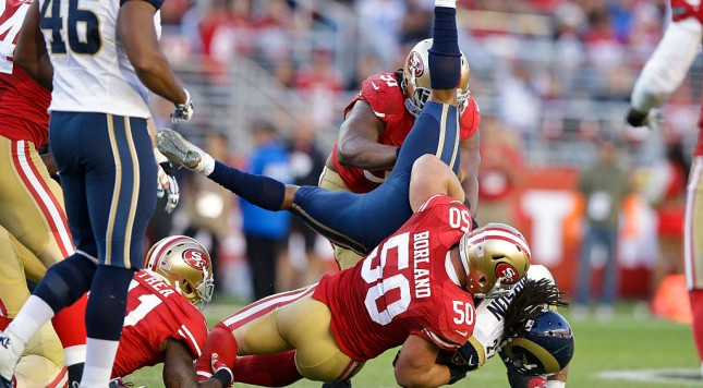 SANTA CLARA, CA - NOVEMBER 02: Tre Mason #27 of the St. Louis Rams is tackled by Chris Borland #50 of the San Francisco 49ers during the fourth quarter at Levi's Stadium on November 2, 2014 in Santa Clara, California.  (Photo by Ezra Shaw/Getty Images)