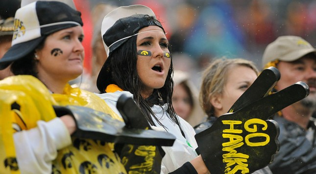 TAMPA, FL -  JANUARY 1:  Fans of the Iowa Hawkeyes cheer in the rain during play against the LSU Tigers January 1, 2014  in the Outback Bowl at Raymond James Stadium in Tampa, Florida.  LSU won 21 - 14.  (Photo by Al Messerschmidt/Getty Images)