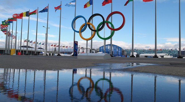 SOCHI, RUSSIA - FEBRUARY 01:  The Olympic Rings are pictured next flags of the competing nations inside the Olympic Park prior to the Sochi 2014 Winter Olympics on February 1, 2014 in Sochi, Russia.  (Photo by Clive Mason/Getty Images)