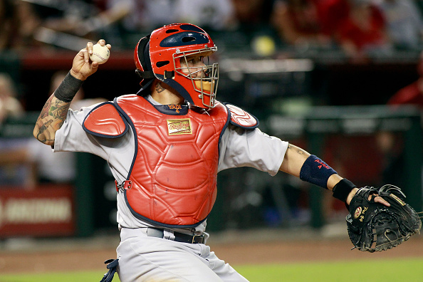 PHOENIX, AZ - AUGUST 26: Yadier Molina #4 of the St Louis Cardinals throws a baseball back to the mound during the ninth inning of a MLB game against the Arizona Diamondbacks at Chase Field on August 26, 2015 in Phoenix, Arizona. The Cardinals defeated the Diamondbacks 3-1. (Photo by Ralph Freso/Getty Images)