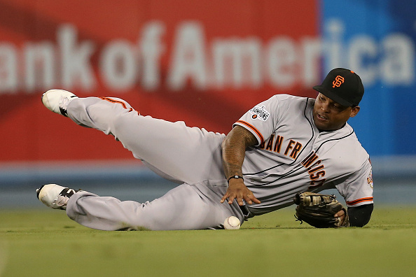 LOS ANGELES, CA - SEPTEMBER 01: Right fielder Marlon Byrd #6 of the San Francisco Giants reaches for the ball after failing to make a sliding catch on a single hit by A.J. Ellis of the Los Angeles Dodgers in the second inning at Dodger Stadium on September 1, 2015 in Los Angeles, California (Photo by Stephen Dunn/Getty Images)